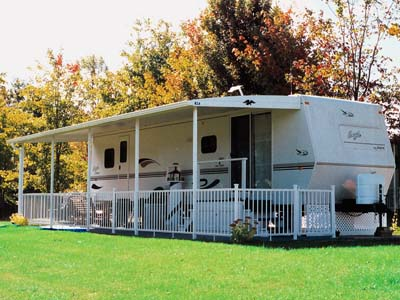 Arched Aluminum Awning On Travel RV With Patio Railing